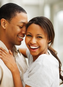 Portrait of a romantic happy young African American couple enjoying