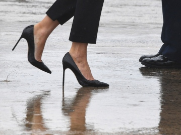 TOPSHOT - First Lady Melania Trump walks on high heels to board Air Force One at Andrews Air Force Base, Maryland, on August 29, 2017 en route to Texas to view the damage caused by Hurricane Harvey. / AFP PHOTO / JIM WATSONJIM WATSON/AFP/Getty Images
